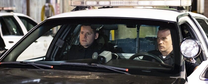 "Luke Kleintank, left, and Thomas Jane as police officers in a ""Crown Vic"" patrol car."