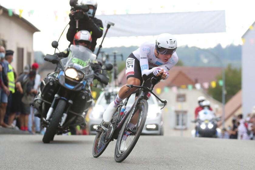 Tadej Pogacar heads toward the finish line during Stage 20 of the Tour de France in La Planche des Belles Filles on Sept. 19.