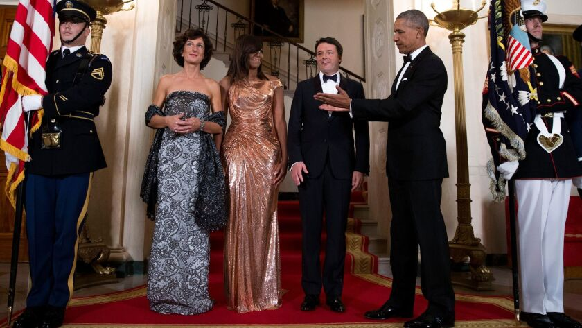 Italy's first lady Agnese Landini, from left, Michelle Obama, Italian Prime Minister Matteo Renzi and President Obama at an October state dinner. The Atelier Versace rose gold chainmail dress gets our vote as one of Mrs. O's most memorable looks.
