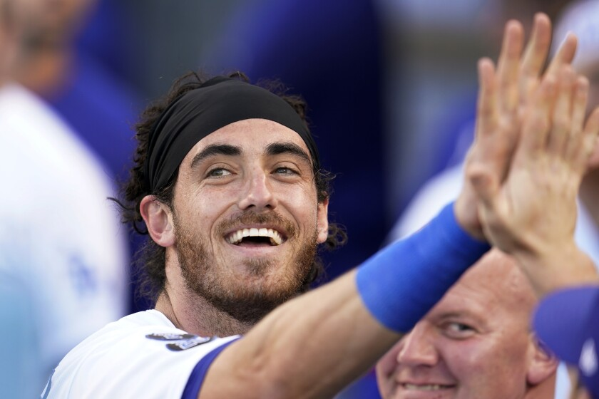 Los Angeles Dodgers' Cody Bellinger smiles in the dugout after scoring on a single by Gavin Lux during the first inning of the team's baseball game against the St. Louis Cardinals on Wednesday, June 2, 2021, in Los Angeles. (AP Photo/Marcio Jose Sanchez)