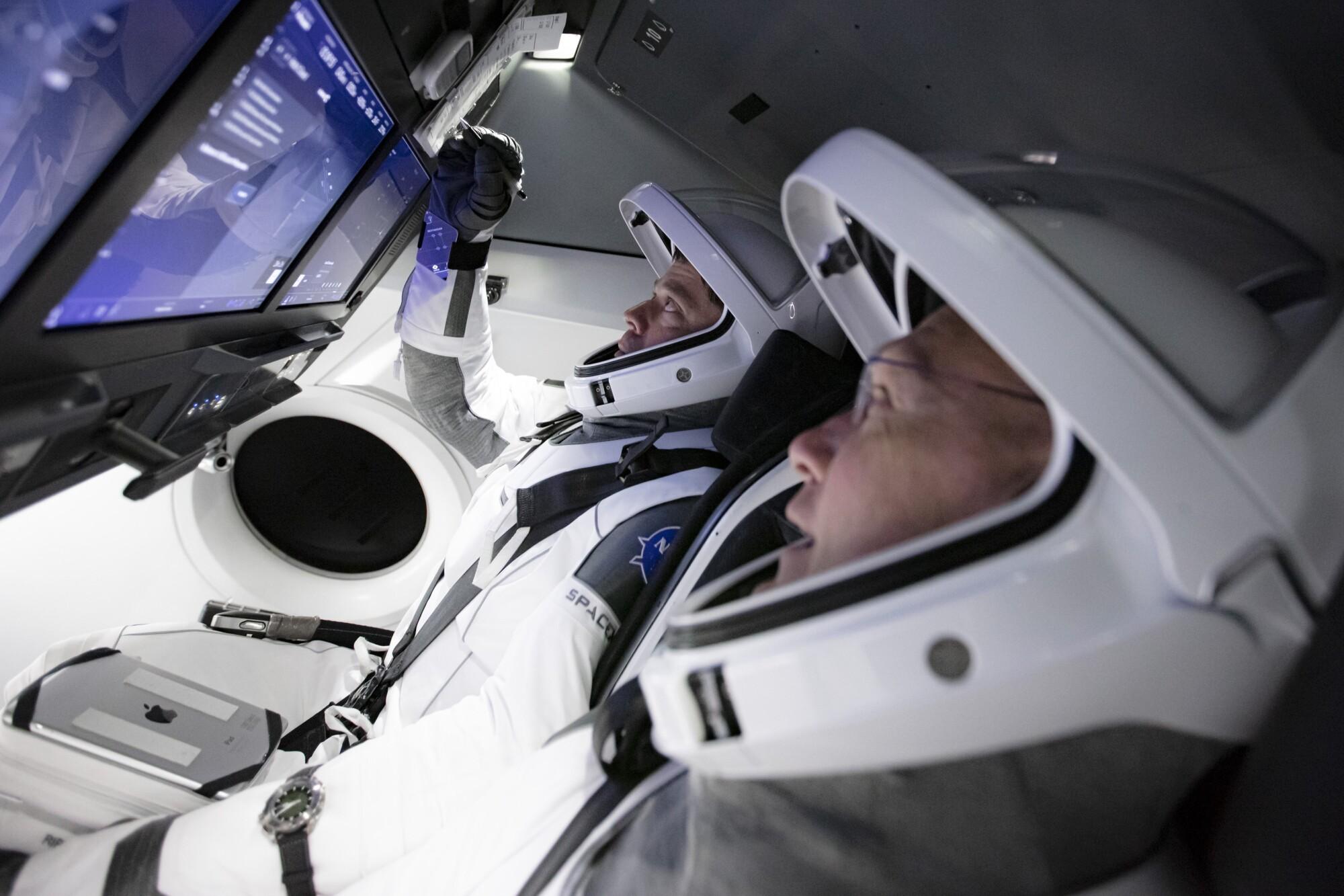 Astronauts practice in SpaceX flight simulator