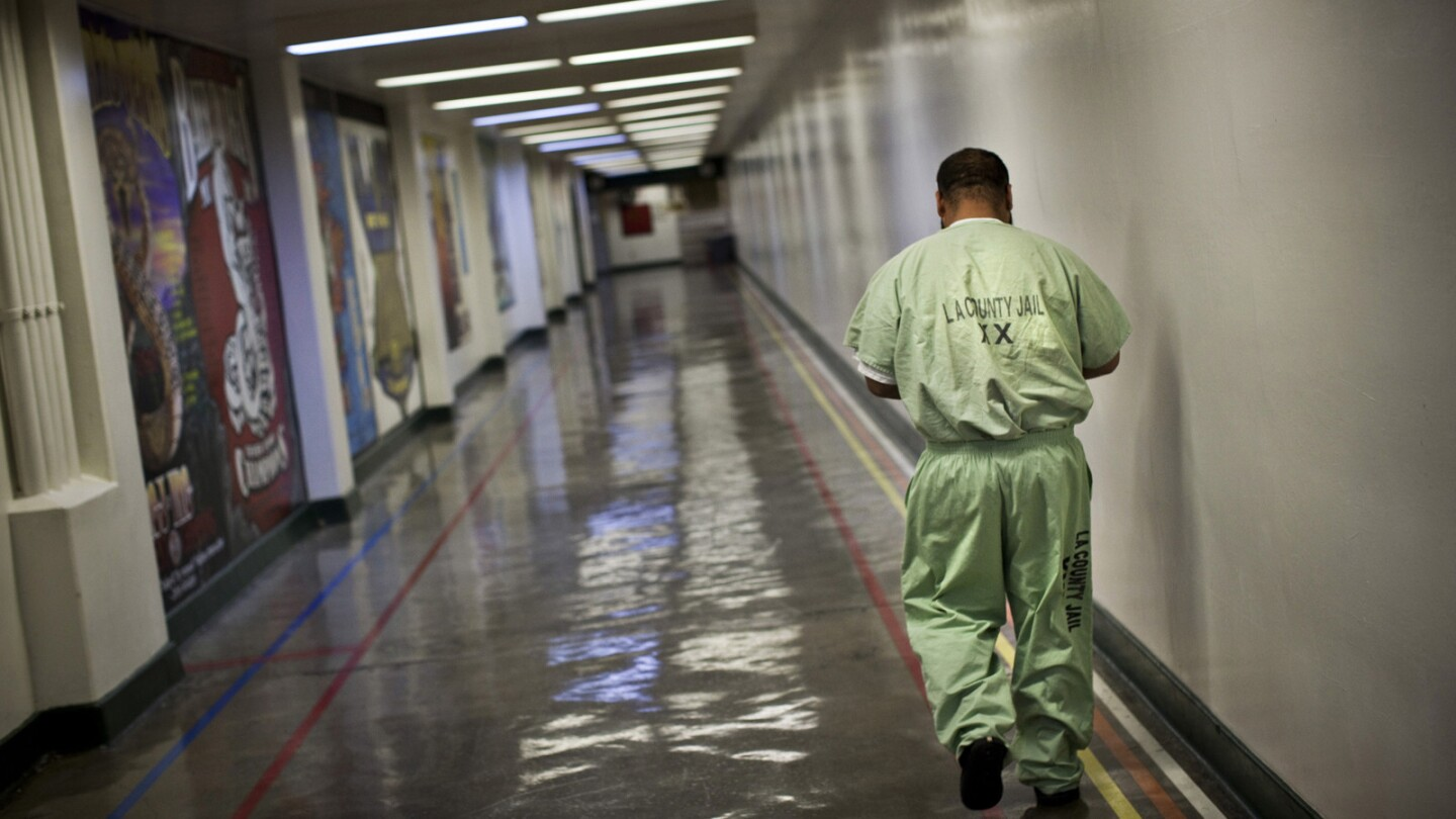 An inmate walks a hallway in Men's Central.