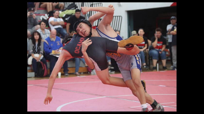 Fountain Valley High School wrestler Thanh Tu takes down Lakewood's Elijah Ocampo in the CIF Southern Section Dual Meet Wrestling Championships, Division 3, 132 lb. match, in Lakewood on Saturday, May 26, 2019.