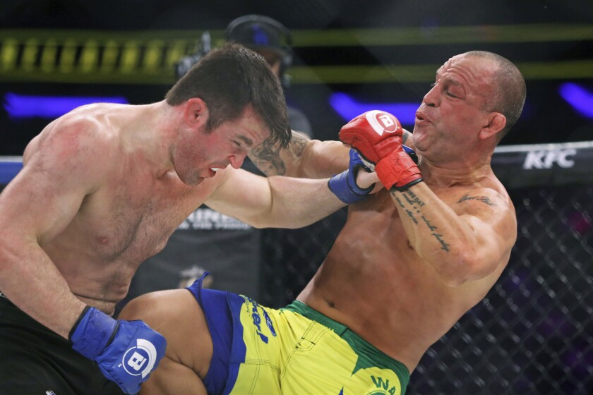 Chael Sonnen, left, trades punches with Wanderlei Silva at Bellator 180 on June 25 in New York.