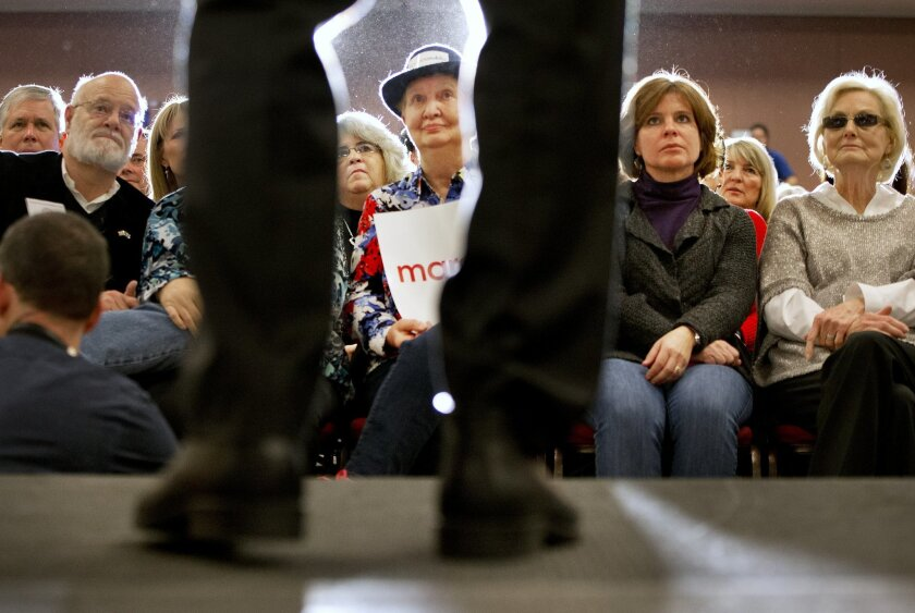 Beverly Gail, of North Myrtle Beach, S.C., center, watches as Republican presidential candidate, Sen. Marco Rubio, R-Fla. speaks during a town hall meeting in Myrtle Beach, S.C., Thursday Feb. 11, 2016. (AP Photo/Jacquelyn Martin)