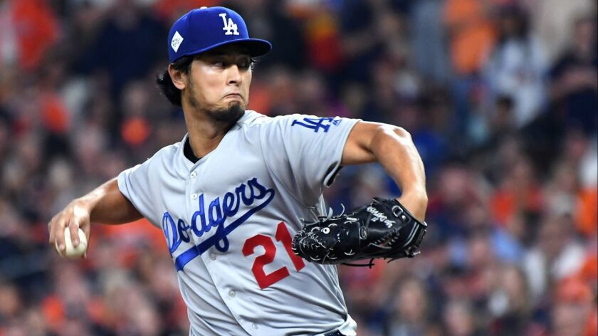 HOUSTON, TEXAS OCTOBER 27, 2017-Dodgers pitcher Yu Darvish throws a pitch against the Astros in Game