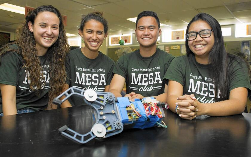 Costa Mesa High School students, from left, sisters Sarah and Sylvia Catania, Keiser Ruiz and Nancy Le show their robotic prosthetic arm, which the team will present this month at the MESA USA National Engineering Design Competition.