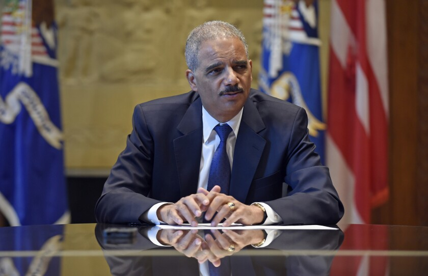 Atty. Gen. Eric H. Holder Jr. speaks during an interview with the Associated Press at the Justice Department on Sept. 16.