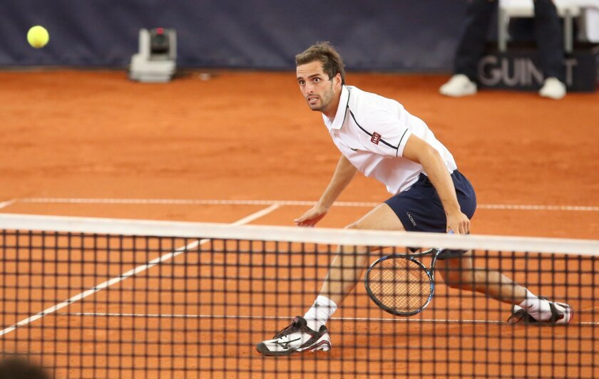 Albert Ramos-Vinolas of Spain returns a shot during his first round match against Nicolas Almagro of Spain at the ATP tennis tournament in Hamburg, Germany, Monday July 27, 2015. (Bodo Marks/dpa via AP)