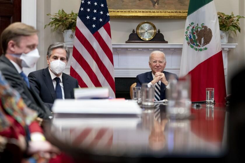 President Joe Biden with White House national security adviser Jake Sullivan, left, and Secretary of State Antony Blinken