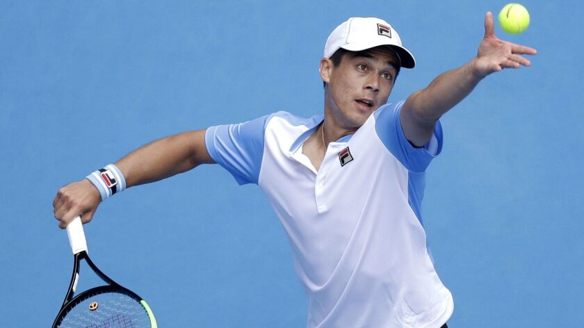 Mackenzie McDonald serves to Croatia's Marin Cilic during their second round match at the Australian Open on Jan. 16.