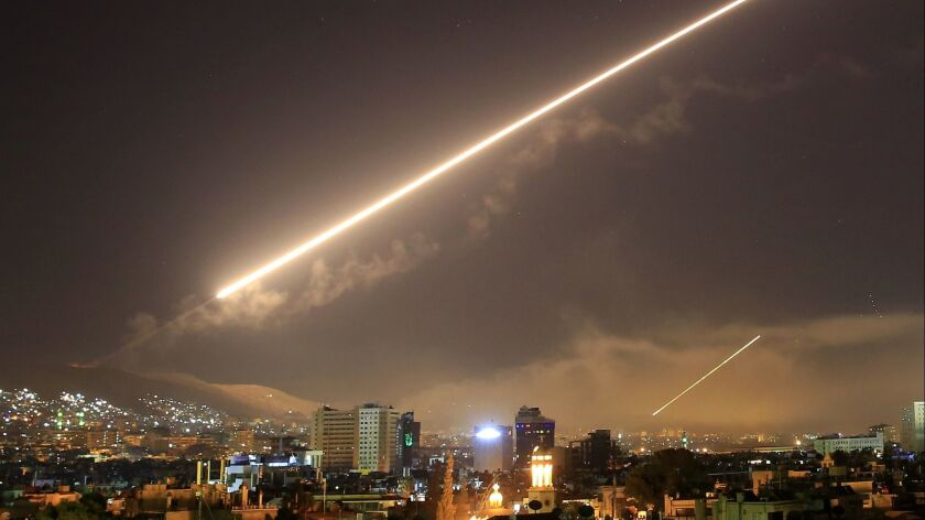 Damascus skies erupt with service to air missile fire as the U.S. launches an attack on the Syrian capital Damascus, Syria on April 14.
