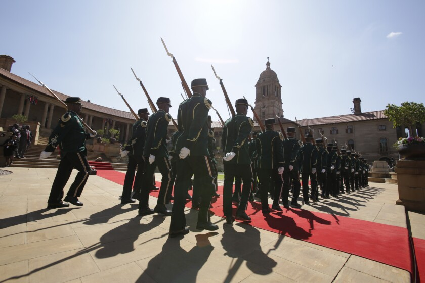 A guard of honour prepare for the arrival of Nigerian President Muhammadu Buhari at a welcoming ceremony in Pretoria, South Africa Thursday, Oct. 3, 2019. Buhari is visiting South Africa's leader, Cyril Ramaphosa, after a wave of attacks on foreigners angered many African countries and led to an extraordinary airlift to take hundreds of Nigerians home. (AP Photo/Themba Hadebe)