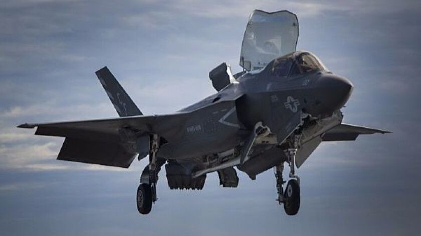 A Marine Corps F-35B lands on an amphibious ship in the Pacific.