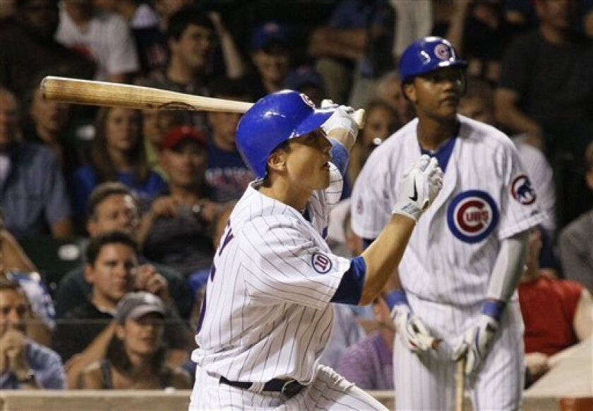 Chicago Cubs' Darwin Barney follows through on an RBI double scoring Tyler Colvin, as Starlin Castro watches from the on deck circle during the eighth inning of a baseball game against the Houston Astros Tuesday, May 31, 2011 in Chicago. (AP Photo/Charles Rex Arbogast)