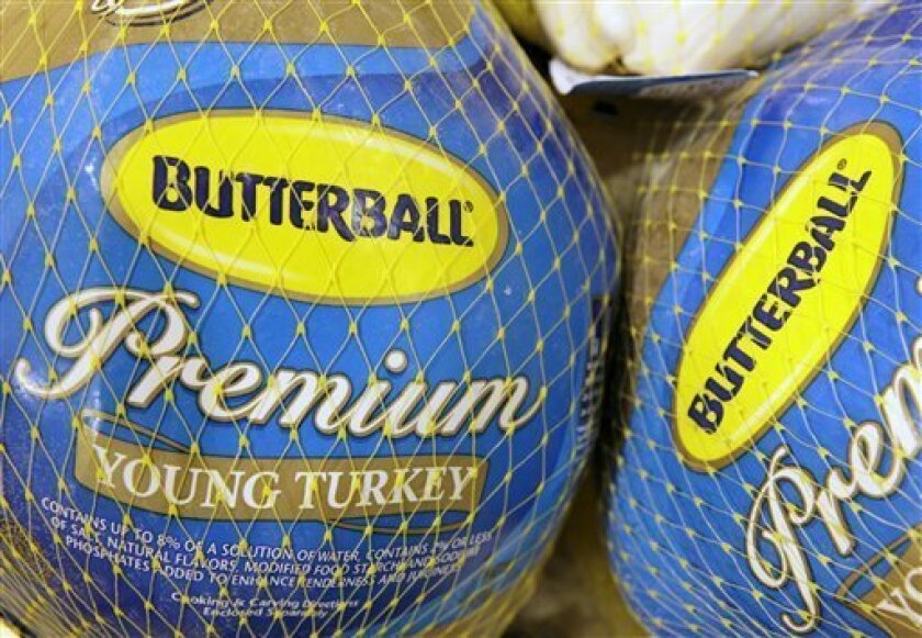 FILE - In this file photo made Dec. 7, 2009, Butterball frozen turkeys are seen on display at Heinen's grocery store in Bainbridge Twp., Ohio. Smithfield Foods said Friday, Sept. 10, 2010, it's selling its stake in Butterball. (AP Photo/Amy Sancetta, file)