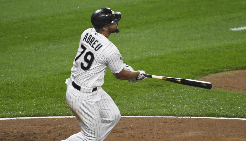 Chicago White Sox's Jose Abreu (79) watches his three-run home run against the Detroit Tigers during the fourth inning of a baseball game, Saturday, Sept. 12, 2020, in Chicago. (AP Photo/David Banks)