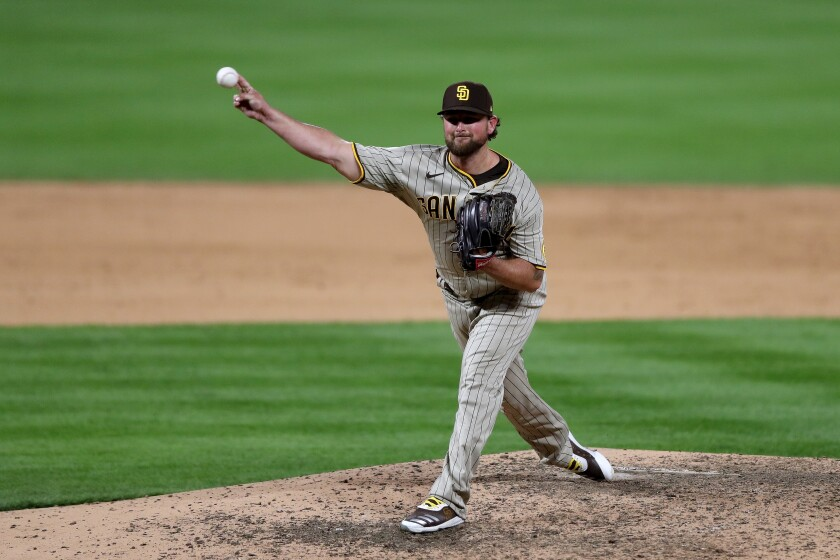 Padres closer Kirby Yates pitches in Friday's ninth inning against the Rockies