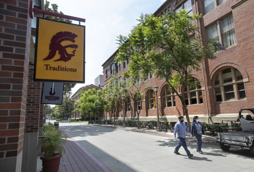 Custodians make their way on the campus of USC.