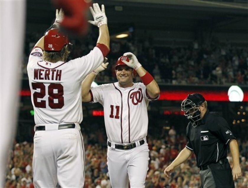 Washington Nationals' Ryan Zimmerman (11) celebrates his two-run home run with Jayson Werth (28) during the eighth inning of a baseball game against the St. Louis Cardinals at Nationals Park Friday, Aug. 31, 2012, in Washington. The Nationals won 10-0.  (AP Photo/Alex Brandon)