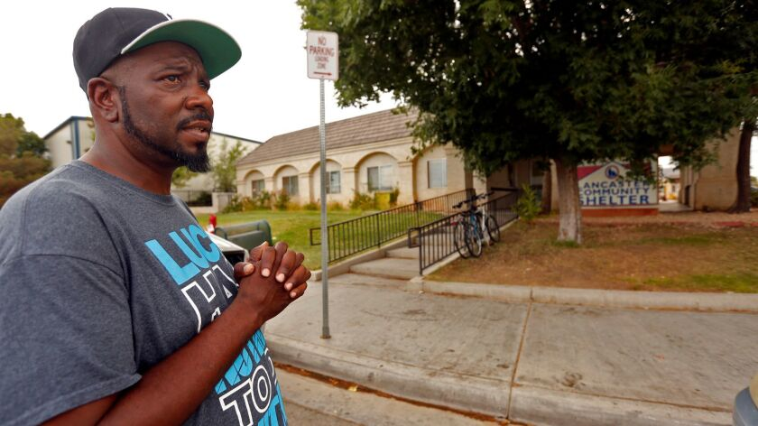 Adam Mandolph, 46, outside the only homeless shelter in the Antelope Valley, the Lancaster Community Shelter, which is set to close Sunday because of financial problems.