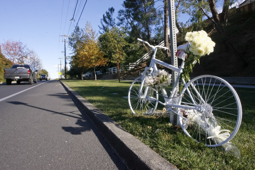 A memorial at the site on Mulholland Highway in Calabasas, where a Los Angeles County sheriff's deputy struck and killed Milton Olin Jr. as he was cycling on Dec. 8, 2013.