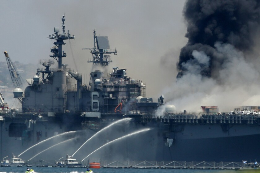 A fire burns on the amphibious assault ship USS Bonhomme Richard.