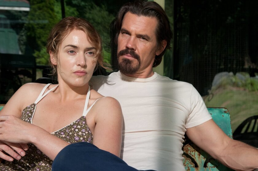 "This image released by Paramount Pictures shows Kate Winslet, left, Josh Brolin in a scene from ""Labor Day."" Winslet's recent filmography is doted with memorable mothers: ""Mildred Pierce,"" ""Carnage,"" ""Revolutionary Road,"" and ""Little Children."" She adds another portrait of motherhood with ""Labor Da"