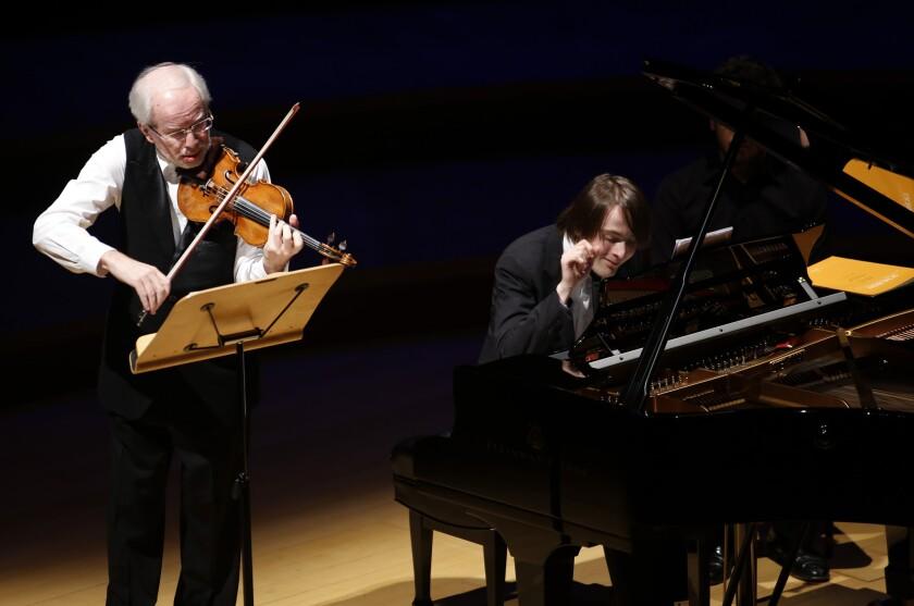 Violinist Gidon Kremer and pianist and Tchaikovsky Competition winner Daniil Trifonov perform at the Disney Concert Hall on Jan. 14, 2015.