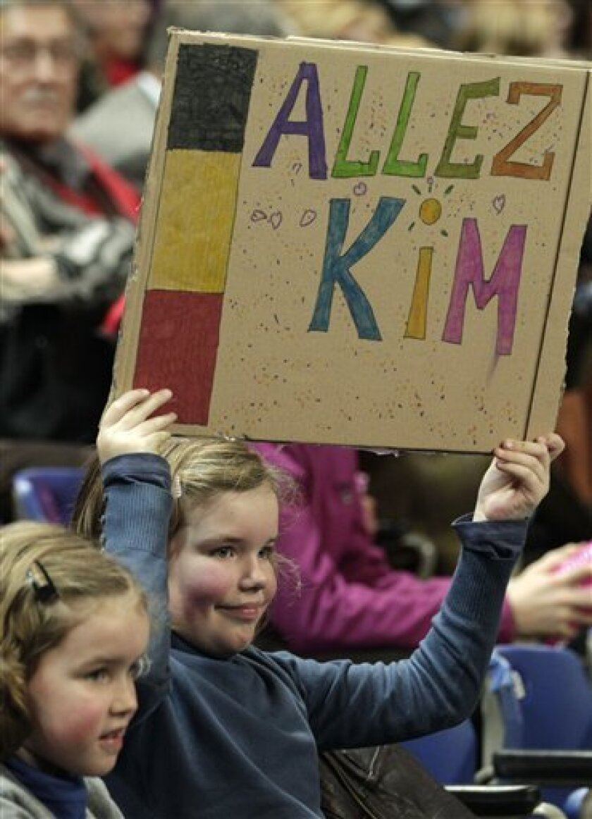 A young supporter of Belgium's Kim Clijsters holds up a placard during the World Group Fed Cup match Belgium versus USA, in Antwerp, Belgium, Saturday, Feb. 5, 2011. Belgium leads on the first day 2-0. (AP Photo/Yves Logghe)