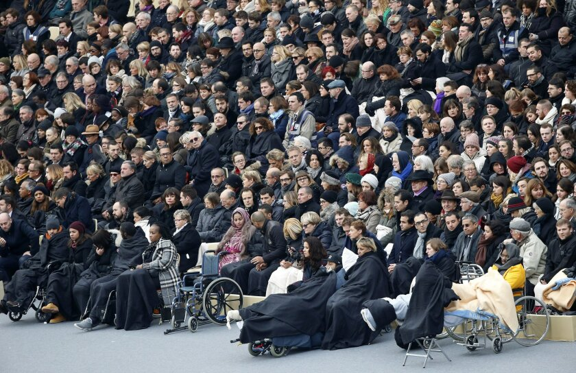 Wounded people in the Nov. 13 Paris attacks wait for the start of a ceremony in the courtyard of the Invalides in Paris, Friday, Nov. 27, 2015. France is mourning and honoring those killed in the Nov. 13 attacks in a somber ceremony presided by French President Francois Hollande. (AP Photo/Francois Mori)
