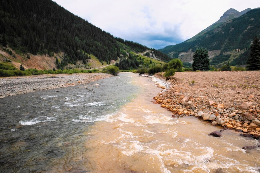 Cement Creek, which was flooded with millions of gallons of mining wastewater, meets with the Animas River in Silverton, Colo.