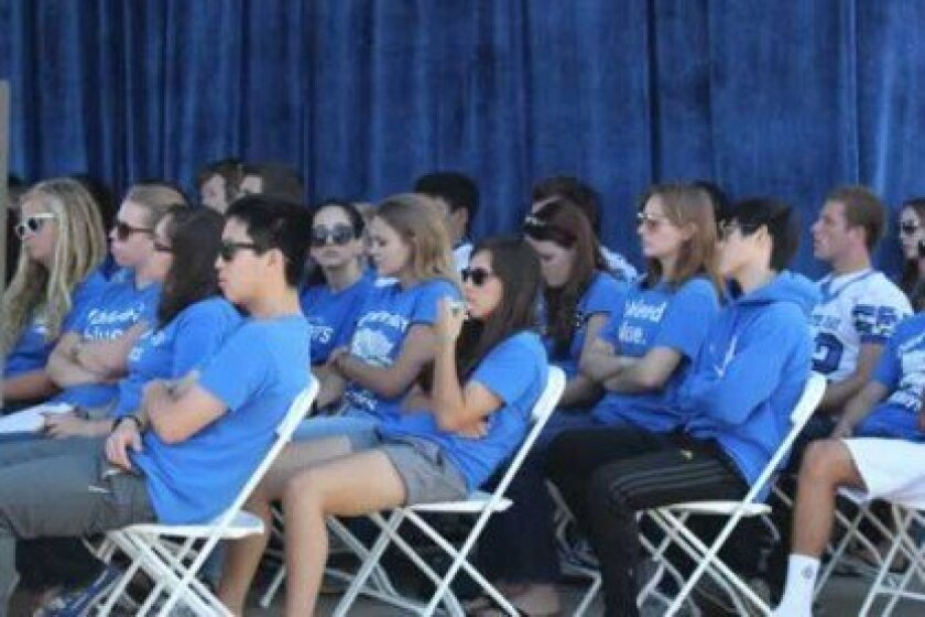 La Jolla Country Day School students endured the mid-day heat to watch mayoral candidates Carl DeMaio and Bob Filner exchange equally heated jabs.