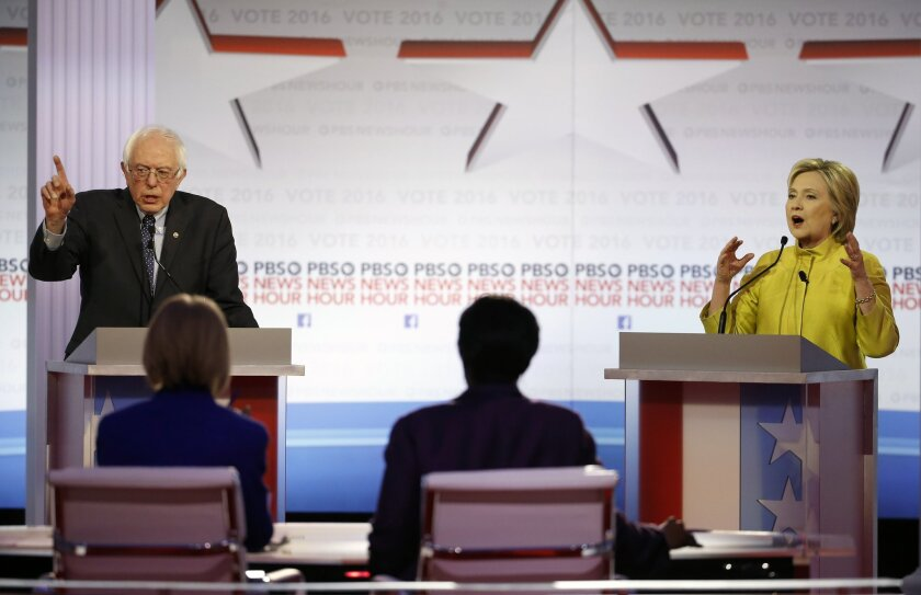 Candidates Sen. Bernie Sanders and Hillary Clinton argue a point during the Democratic presidential primary debate at the University of Wisconsin-Milwaukee.