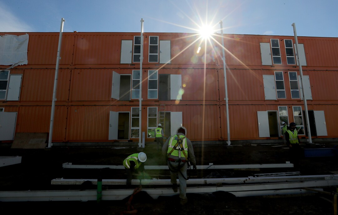 Contractors are rushing to complete a 232-unit homeless housing project in L.A.