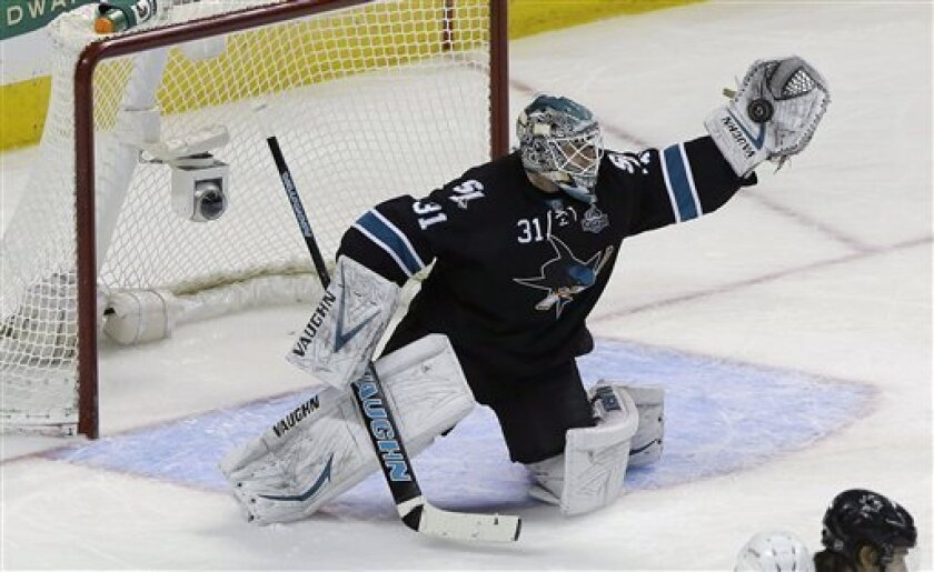 San Jose Sharks goalie Antti Niemi (31), from Finland, catches the puck against the Detroit Red Wings during the first period of an NHL hockey game in San Jose, Calif., Thursday, Feb. 28, 2013. (AP Photo/Jeff Chiu)