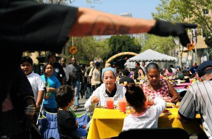The number of people living in poverty stood at 46.5 million last year, or 15% of the country's population. That left the poverty rate at close to the peak since the War on Poverty began in 1965. Above, people enjoy a meal during this year's annual Good Friday event at the L.A. Mission.