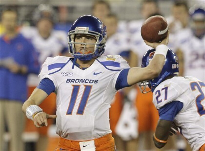 FILE - In this Jan. 4, 2010 photo, Boise State's Kellen Moore (11) passes the ball against TCU during the second quarter in the Fiesta Bowl NCAA college football game in Glendale, Ariz. Much like the Boise State team he leads, Moore is more then sum of his part, an undersized and overlooked small-town kid who has turned out to be Heisman Trophy contender. (AP Photo/Ross D. Franklin)