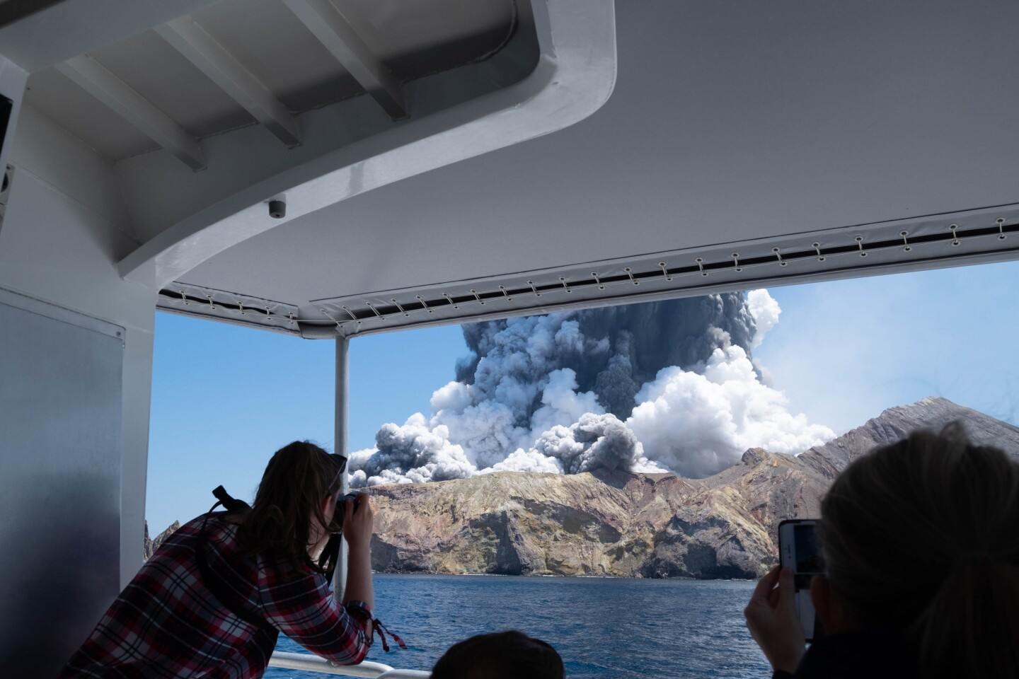 Editorial use only. MANDATORY CREDIT: MICHAEL SCHADE /NO SALES Mandatory Credit: Photo by MICHAEL SCHADE/EPA-EFE/REX (10495187b) An image provided by visitor Michael Schade shows White Island (Whakaari) volcano, as it erupts, in the Bay of Plenty, New Zealand, 09 December 2019. According to police, at least five people have died in the volcanic erruption at around 2:11 pm local time on 09 December. The island is located around 40km offshore of the Bay of Plenty. New Zealand's White Island volcano erupts - 09 Dec 2019 ** Usable by LA, CT and MoD ONLY **