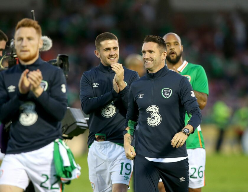 Republic of Ireland's Robbie Keane, right, and team mate Robbie Brady smile after the final whistle of the international friendly soccer match against Belarus at Turners Cross, Cork, Ireland, Tuesday May 31, 2016. (Brian Lawless/PA via AP)  UNITED KINGDOM OUT