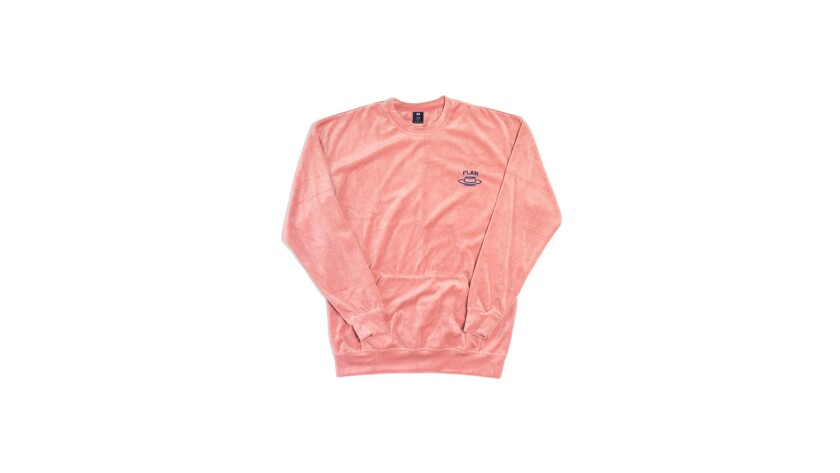 A unisex rose-colored velour crewneck from Flan. $150. flanlabs.com Credit - Flan