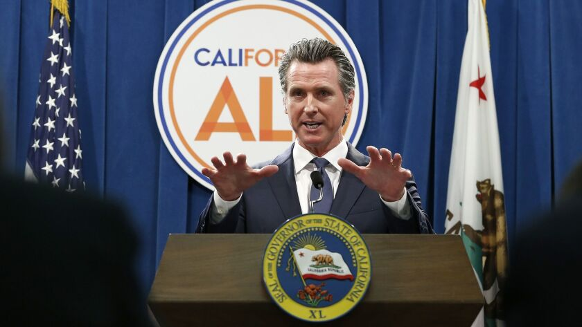 Gov. Gavin Newsom discusses his revised 2019-2020 state budget during a news conference in May.