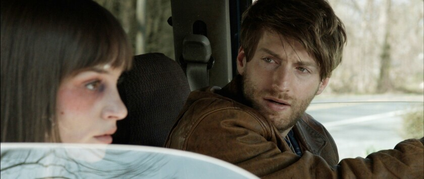 """Fran Kranz and Jocelin Donahue in a scene from the film """"The Living."""""""