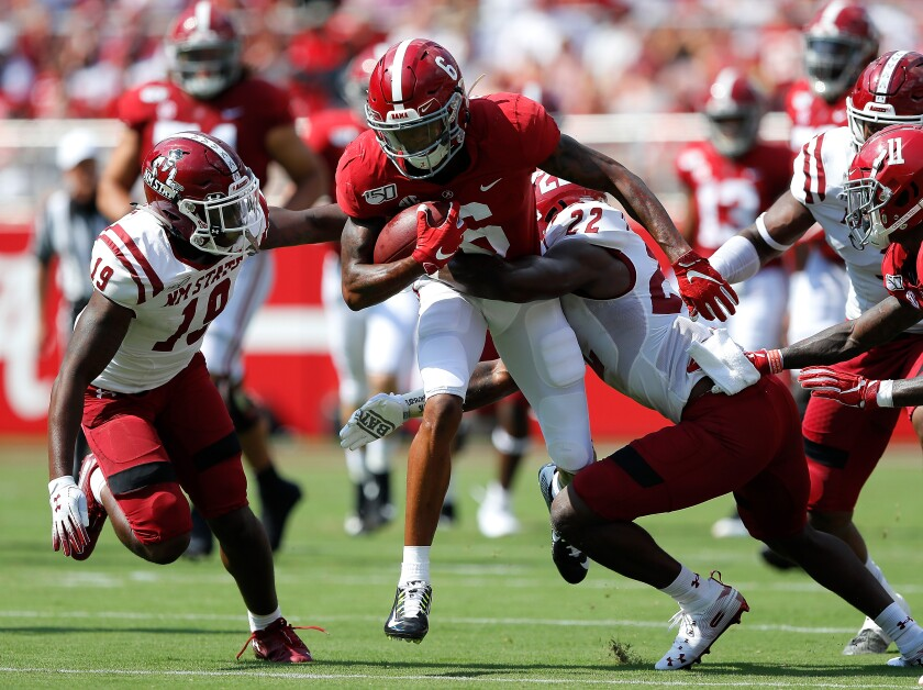 Alabama wide receiver DeVonta Smith tries to break a tackle during a win over New Mexico State.
