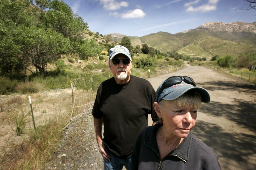 Hazy Meadow Ranch owners Larry Stewart and his wife, Linda Hayes, worry that the Sunrise Powerlink and water districts' sand-mining operation will ruin El Monte Valley.