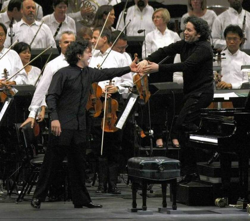 Pianist Sergio Tiempo, left, and Gustavo Dudamel perform at the Hollywood Bowl on Aug. 16, 2012.