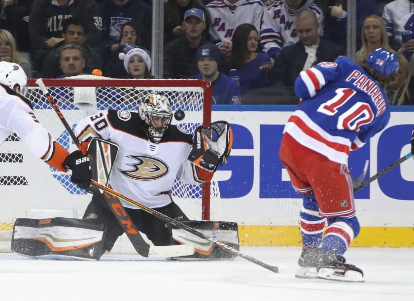 Ducks goaltender Ryan Miller stops a shot by New York Rangers forward Artemi Panarin.