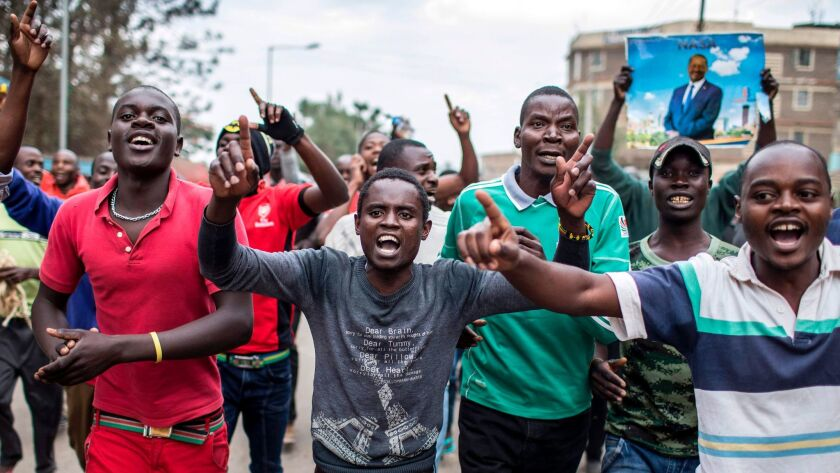 Supporters of Kenyan opposition candidate Raila Odinga take part in a march in the Mathare slum in Nairobi on Aug. 10, 2017.