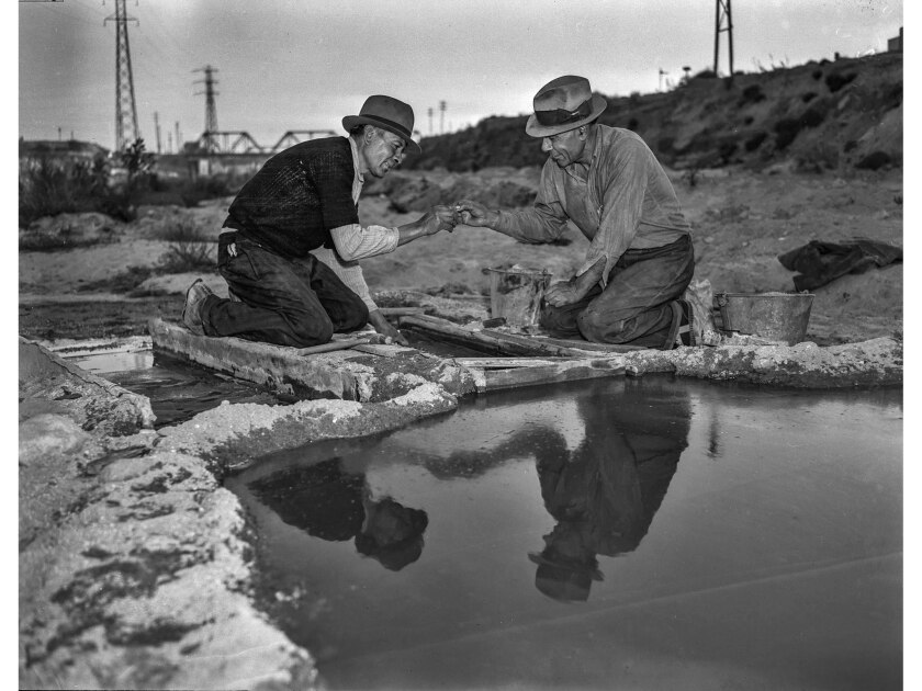 Dec. 11, 1938: Two prospectors, Joe Parra, left, and E. Rea, examine a gold nugget found in sand in Los Angeles River.