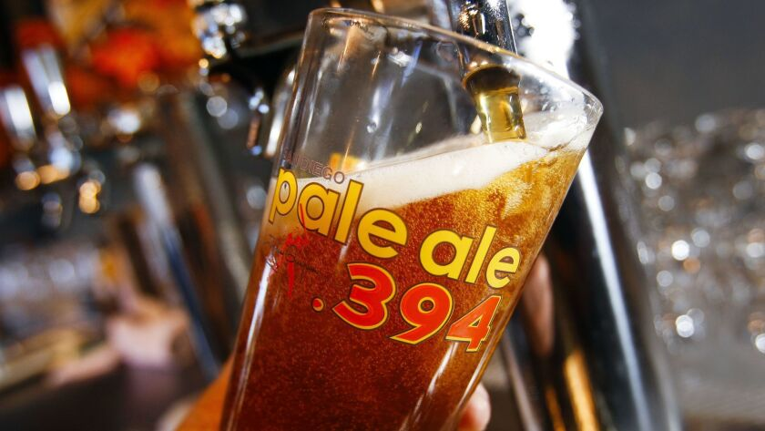A San Diego Pale Ale .394 is poured at AleSmith Brewing Company.